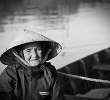 Vietnam - Begger on canoe in Hoi Ann by Chris Bishop