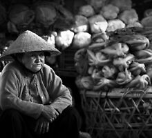 Vietnam - Eldery woman at markets by Chris Bishop