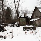 In winter - old farmer house by Antanas