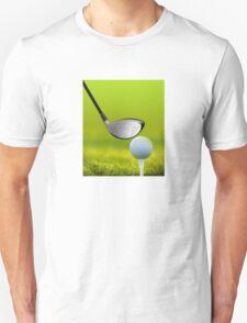 Golf ball and driver on green grass Unisex T-Shirt
