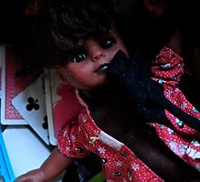 creepy doll with playing cards by ashley hutchinson