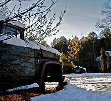 Old rusty truck on abandoned property by ashley hutchinson