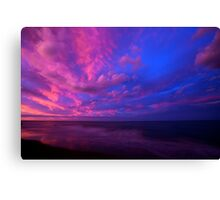 Opposing the sunset Canvas Print