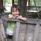 Child in wooden trailer by misskris