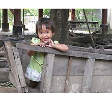 Child in wooden trailer Photographic Print