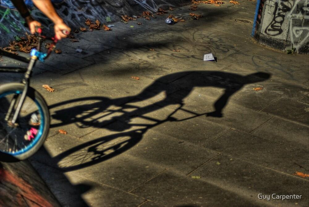 BMX biker shadow by Guy Carpenter