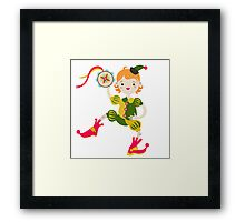 Boy role game playing as a clown. Framed Print