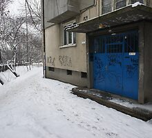 Graffitied block entrance of a dilapidated building by BSBenev