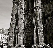 Biking below the Strasbourg Cathedral by kweirich