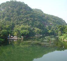 Wooden Raft Near Guilin China by Alecia Hoobing