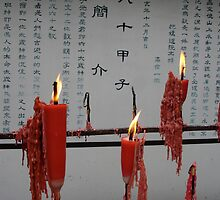 Candles in Buddhist Temple by Alecia Hoobing