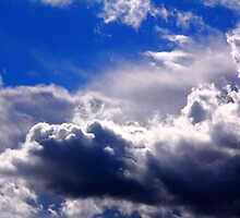 dramatic clouds in the blue sky by Orderposter
