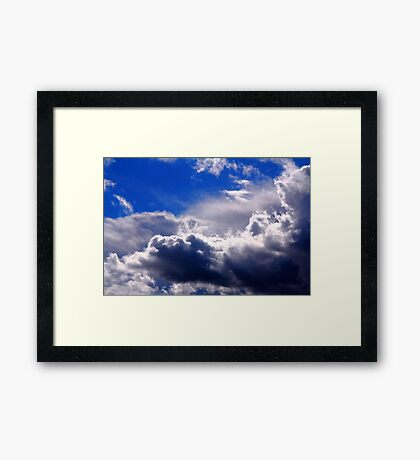 dramatic clouds in the blue sky Framed Print