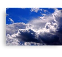 dramatic clouds in the blue sky Canvas Print