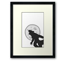 Werewolf howling at the moon Framed Print