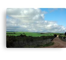 Green pastures and fluffy white clouds Canvas Print