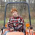 Jasper on small tractor, Steep Hollow Farm by Christianne White