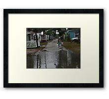 Chasing puddles  ( Trailer Park America Series) Framed Print