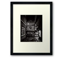 Tucking history away for the night Framed Print