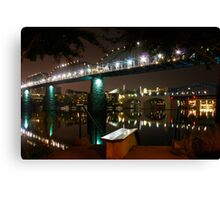 Bridge over smooth water Canvas Print