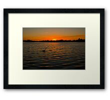 Sunset over the water, opened by David Attenborough Framed Print