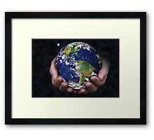 Holding the Earth Framed Print