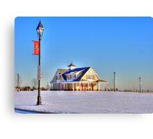 Beach house in the snow-full Canvas Print