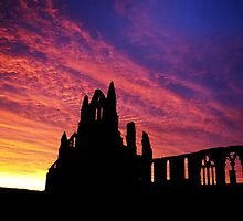 Whitby Abbey silhouetted by the sunrise by Guy Carpenter