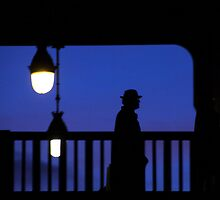 Paris - Silhouette on blue. by Jean-Luc Rollier