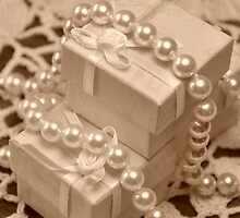 Sepia jewelry boxes and pearls on lace by mltrue