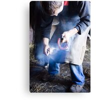 Farrier measuring hot shoe for size Canvas Print