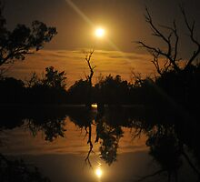 Moonrise reflections by Wayne England