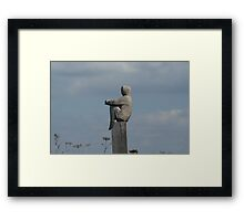 person on pole Framed Print