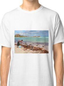 Guy feeding pelicans in Tulum Beach, MEXICO Classic T-Shirt