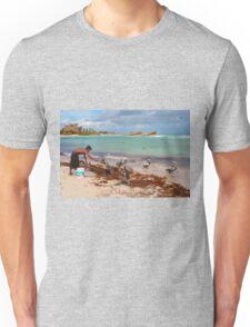 Guy feeding pelicans in Tulum Beach, MEXICO Unisex T-Shirt