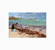 Guy feeding pelicans in Tulum Beach, MEXICO Unisex T-Shirt