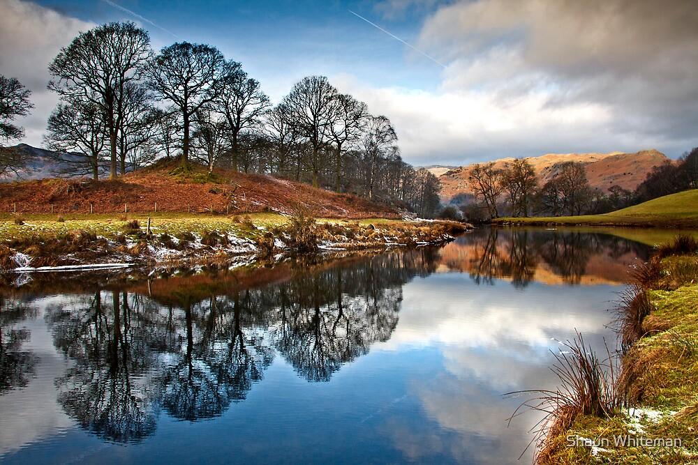 Winter sunlight on distant fells by Shaun Whiteman