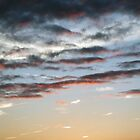 Sunsets & Clouds by Paul  Green