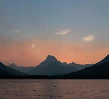 Sunset Over Mt. Wilbur And Swiftcurrent Lake by Alex Preiss