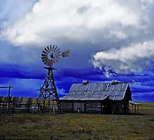 1910 log barn and storm cloud by Lee Gunderson