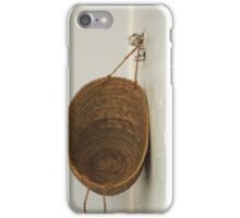 basket on a white brick wall iPhone Case/Skin