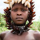 YOUNG MURSI GIRL DECORATED WITH SHELLS AND BEETLES WINGS by Nicholas Perry