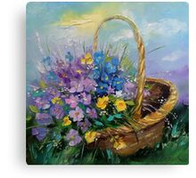 Bouquet of wild flowers in a basket Canvas Print