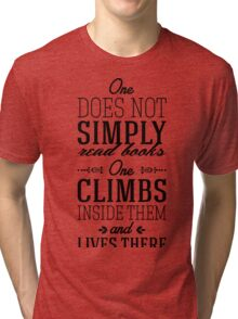 One does not simply read books - one climbs inside them and lives there. Tri-blend T-Shirt