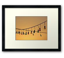 String of Multicoloured Light Bulbs at Warm Sunset Framed Print