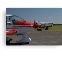 Tow planes waiting in line. Canvas Print