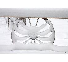 Saggy Snow Covered Wagon Wheel Photographic Print