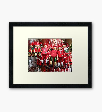 Colourful Red Toy Puppets in Prague Market Square Framed Print