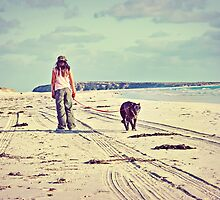 Girl Walking Dog On Lonely Beach by sallydexter