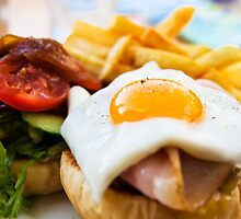 beef wagyu burger with bacon, ham, egg, chips and vegetables by Leonardo Tarjadi